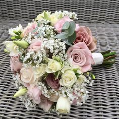 Dusky roses and gypsophila give this pretty bouquet a vintage edge