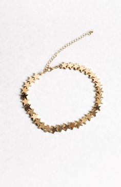 You're a star baby gal! Let your light twinkle and shine brighter in this totally glam Celestial choker in gold! Glam up your date night outfit or add a touch of dazzle to that Coachella worthy festival outfit you know you're dying to try out! This gold choker features a row of 32 gold stars perfectly placed that'll have them saying they love you (and your choker) to the stars and back! This little golden baby also features a jewellery clasp and longer thin chain to allow adjustability…