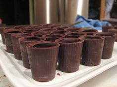 Chocolate Shot Glasses - Since the shooters pre-made are relatively expensive, the mold is a good investment, especially since you can find them for pretty cheap. Just make sure you've got your technique down so you don't waste any chocolate Chocolate Shot Glasses, Chocolate Shots, Honey Chocolate, Chocolate Candy Molds, Chocolate Cups, How To Make Chocolate, Shot Glass Desserts, Dessert Shots, Small Desserts