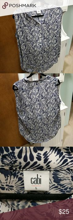CAbi Plaza Sleeveless Shirt Blouse CAbi Plaza Sleeveless Shirt Blouse. Spring 2016 style #5038. Size Large. Excellent preowned condition. Worn once. No rips, pulls, stains. Looks great with the blue cardigan in my closet. CAbi Tops Blouses