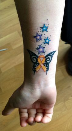 My awesome tattoo for childhood cancer awareness