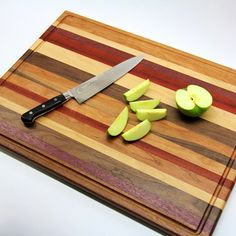 How to make a scrap wood cutting board. Love the stripes. One day I will get the other half to do this.