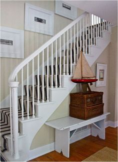 like the white painted staircase, white frames and mattes, and the striped stair runner  designed by stephen saint onge