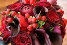 Bouquet of Black Baccara roses, red hypericum berry, burgundy ranunculus, schwarzwalder mini calla liies, red tulips