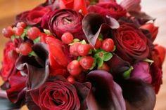 Bouquet of Black Baccara roses, red hypericum berry, burgundy ranunculus, schwarzwalder mini calla liies, red tulips