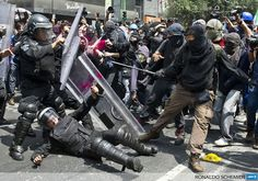 MEXICO, Mexico City: Demonstrators clash with riot police during a protest on September 1, 2013, in Mexico city. AFP PHOTO/RONALDO SCHEMIDT