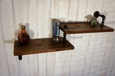 Hey, I found this really awesome Etsy listing at http://www.etsy.com/listing/108612913/industrial-pipe-with-reclaimed-wood