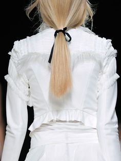 nina ricci spring 2014 ribbon ponytail  Secure a low pontail with elastic, then tie a ribbon to conceal the band.