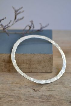 Sterling Silver Hammered Flat Bangle // Solid by HannahBatstone