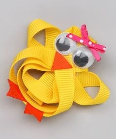 How fun is this?! Hand sculpted by me, made out of grosgrain ribbon and big googly eyes. Attached to a lined alligator clip.