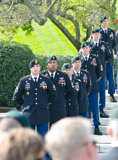 Green Berets from each of the seven Special Forces Groups stand in cordon formation at the gravesite of President John F. Kennedy, Oct. 18, as part of the commemorative Wreath Laying Ceremony held by the U.S. Army Special Forces Command (Airborne) at Arlington National Cemetery. The event paid tribute to JFK's vision of building a dedicated counterinsurgency force, a vision that helped build the Green Berets into an elite force recognized around the world.