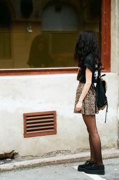 black creepers, black tights, leopard print skirt, black shirt, black backpack