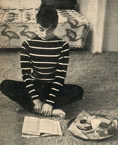 "Audrey Hepburn reading...She famously wrote, ""I believe in pink. I believe that laughing is the best calorie burner. I believe in kissing, by merle"