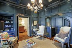 2135 Tangley St Houston, TX 77005: Photo The divine, paneled study is painted a beautiful, high gloss Farrow & Ball color, appointed w/a wet bar & fireplace flanked w/built-ins. An elegant, crystal cube chandelier by designer E.F. Chapman for Visual Comfort, is the focal point in this room.