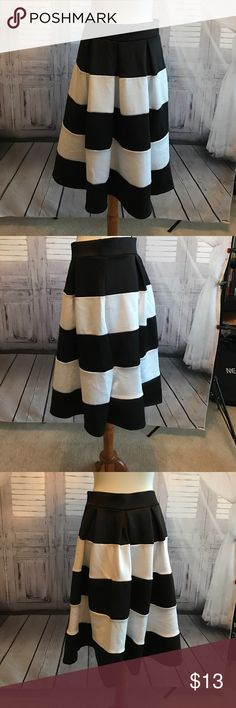 Black and white striped skirt Very cute black-and-white striped skirt with elastic band at waist. Great for upcoming spring events. Size large but I am a 8/10. Super thick good quality material! Never been worn! Skirts A-Line or Full
