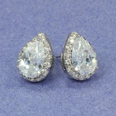Melodie earrings, pear shaped cubic zirconia surrounded by smaller cz's.
