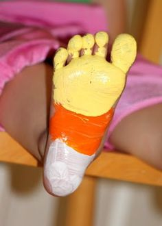 Candy Corn Foot Print...stamp onto paper and write TRICK OR TREAT SMELL MY FEET.