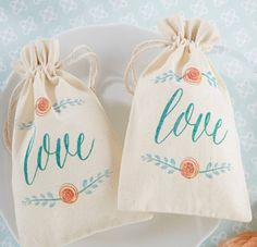 'Love In Bloom' Botanical Muslin Favour Bag. Beautiful, soft blooms are very on trend for weddings. These beautifully botanical inspired favour bags make the perfect favour.