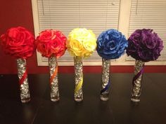 Tall rainbow centerpieces with kisses inside