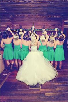 I am pretty sure that the bride is holding a bud light bottle and I know a bridesmaid is holding a bottle of Jack. Lindsay Comparato, this could be us!