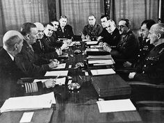 LC-USZ62-98901: Casablanca Conference, January 14-24, 1943. Casablanca, Morocco. American and British chiefs of staff in conference in the Anfa Hotel. Left of the conference table (foreground) Admiral E.J. King, General Marshall, Lt. General Arnold. Right of the conference table (foreground) Field Marshal John Dill, Air Chief Marshal Sir Charles Portal, General Sir Alan Brooke, Admiral Sir Dudley Pound, and Lord Louis Mountbatten Office of War Information Photograph.