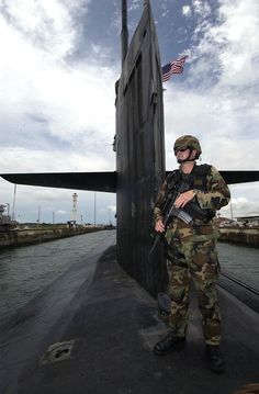 Panama Canal (Aug. 21, 2004) - Master-at-Arms 1st Class James Farrar, assigned to Mobile Security Detachment Two Two (MSD-22), provides security for the USS Portsmouth (SSN 707) as the submarine transits through the Panama Canal. Portsmouth, a Los Angeles-class fast attack submarine, is transiting to Norfolk, Va., where she is scheduled for decommissioning in September 2004. U.S. Navy photo by Photographers Mate 1st Class David A. Levy (RELEASED)