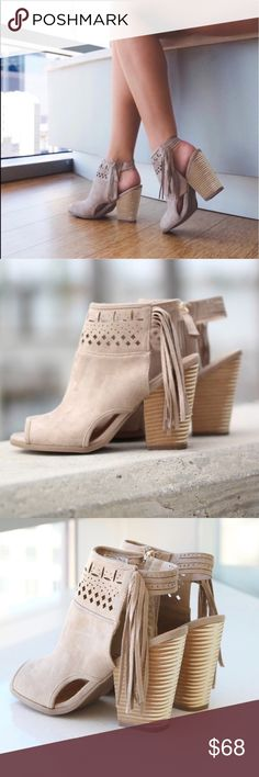 "Cream Open Toe Boho Fringe Booties I am loving these Cream Open Toe Fringe Booties. They are simply adorable, the perfect booties for any occasion! The cream color and fringe go with ANYTHING! Pair these adorable booties with a pair of distressed jeans. Fits: True to Size Heel: 4"". Small Inner Zipper  Open Back Open Toe  Faux Suede Wooden Heel Fringe Detail Cut Out Detail Boutique Shoes Sandals"