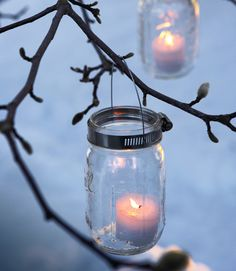 Illuminate bare branches with homemade candleholders. Fashion your own votives with a set of mason jars, hose clamps, and floral wire.   - GoodHousekeeping.com