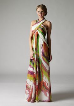 £185  Perfect for cruises, garden parties and summer balls, or just as a stylish maxi dress. This beautiful printed chiffon dress is a real head turner. The unique cross-over halter neck allows for a comfortable fit, and the empire cut to the front is flattering to all. With a simple zip fastening, this lightweight gown is ideal if you are travelling to your event. Either way you are sure to look elegantly relaxed.  The gown comes complete with matching wrap