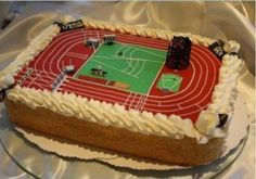 track and field birthday cake. hurdlers, high jump, pole vault, shot put, track