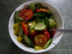 Perfect light lunch under 100 calories. Summer garden veggies tossed in olive oil, sea salt, and freshly cracked black pepper. Tomato, cucumber, bell pepper