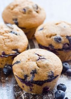 Clean Eating Blueberry Muffins -- Fantastically delicious and light, made with spelt or whole wheat flour and applesauce.