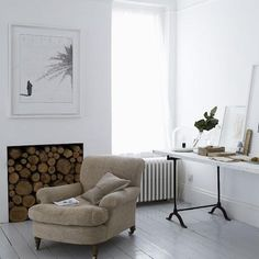 In photographer Paul Massey's London house, a minimalist fireplace opening is filled with stacked wood.
