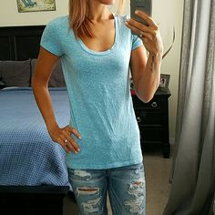 """American Eagle Scoop Neck Tee Beautiful heathered light blue. Very complementary! Has been worn many time but is still in great condition!   * NO TRADES / holds * anyone asking """"lowest"""" or """"trade"""" will be ignored * price firm unless bundled American Eagle Outfitters Tops Tees - Short Sleeve"""