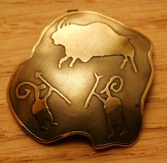 Brass pendant with ancient scene of huntig engraved. These kind of pictures have found in caves, so called Cave art  Pendant has 3.5 cm or 1.35 inch