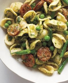 Pesto orecchiette with chicken sausage: Cook the pasta adding the 1/2# gr beans cut into 1-in pieces and 1 c frozen peas w 3 min left, keep 1 c of cooking water, drain pasta and veggies and return to pot. Meanwhile cook 8oz sausage in skillet in olive oil. Add sausage, 1/3 c pesto, 1/2 c parmesan, 1/2 c cooking water to pasta and veggies, toss together and serve