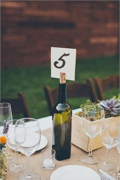Take your empty wine bottles and turn them into gorgeous, unique table cards