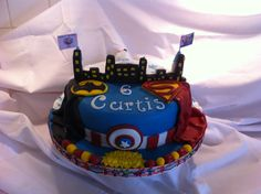 Double sided supper hero and frozen theme cake.