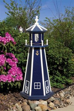 Amish Poly Vinyl Outdoor Lighthouse.  This is similar to the one I have, with a solar panel to make the light.  Love it on my lake!