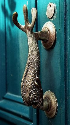 Aqua blue door with a fish handle for the ocean home~