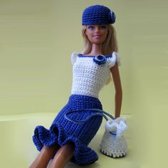 This crocheted barbie outfit consists of white blouse and blue skirt, additional accents - blue hat and white shoulder bag. All are crocheted with 100% cotton thread Perle 5.