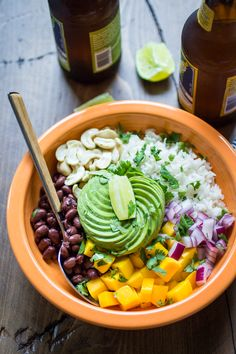 Vegan Brazilian Bowls are loaded with creamy coconut rice, black beans, mango, avocado, and cashews.