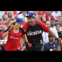 Rob Riggle tries to out Olivia Holt during the The All-Star Legends & Celebrity Softball Game at Great American Ballpark on Sunday, July 12. The Enquirer/Amanda Rossman