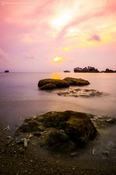 I took this photo during the sunset time of Tioman Island, Malaysia. I used ND filter to get long exposure effect.