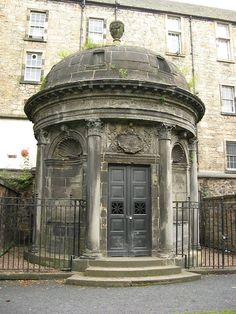 The black mausoleum in Greyfriars Cemetery, Edinburgh, Scotland - burial site of 'Bloody' George Mackenzie. One of the most haunted and perhaps notorious of Scotland`s cemeteries is that of Greyfriars. Places In Scotland, Scotland Travel, Edinburgh Scotland, Most Haunted Places, Spooky Places, Haunted Graveyard, Haunted Houses, Destinations, Art Sculpture