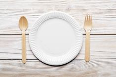 Wooden single use kitchenware on white table. Top view, space fo by e_mikh. Wooden single use kitchenware on white table. Top view, space for text. Table Top View, White Table Top, Kitchenware, Tableware, Wooden Tables, Food Photo, Household, Plates, Space
