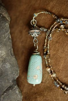 "Michigan ""Leland Blue"" slag glass carved pendant by Gary Wilson married with antique beads, gemstones and silver.  Sold."