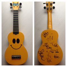 A uke signed by all the members of the Ukulele Orchestra of Great Britain.
