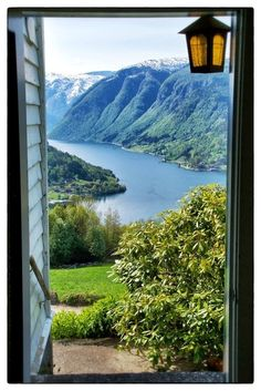 Fjord View, Hardangerfjord, Norway. What a view. I would like to wake up to that.