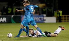 Dundalk midfielder Ronan Finn hits the floor under pressure from Zenit duo Nicolas Lombaerts and Axel Witsel